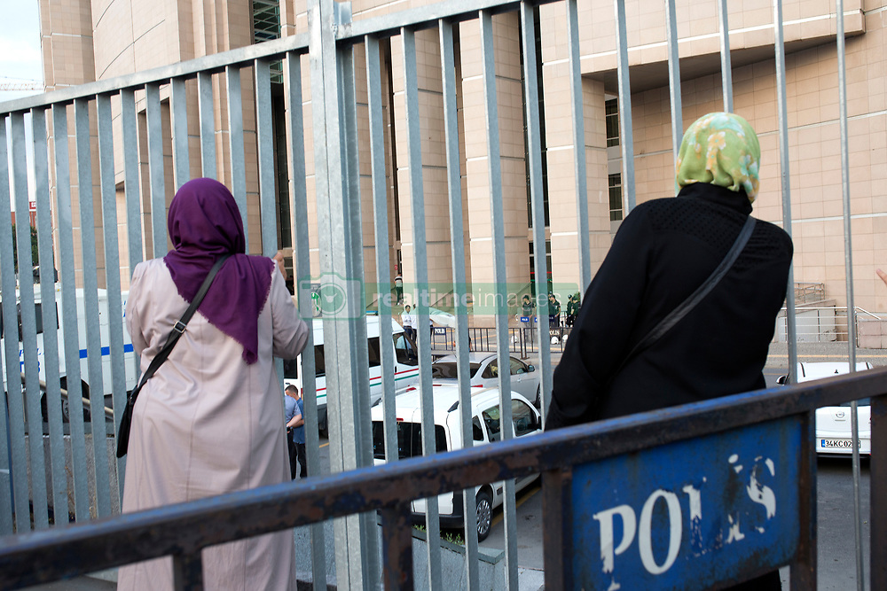 """Two women wait in front of Istanbul's courthouse. A Turkish court was due on July 28 to decide whether to release journalists from the opposition newspaper Cumhuriyet jailed on charges of supporting """"terrorism"""", in a trial seen as a test for press freedom under President Recep Tayyip Erdogan. The court decided for continuation of arrest of 5 of the total of 19 defendants: chief editor Murat Sabuncu; journalists Kadri Gürsel and Ahmet Şık; executive board member Akın Atalay, and, Kemal Aydoğdu, an individual not affiliated with Cumhuriyet but tried in the case over accusation of being the holder of the Twitter account named as Jeansbiri.<br /> Member of the executive board of Cumhuriyet Foundation Önder Çelik, columnist Hakan Kara, ombudsman Güray Öz, lawyer Mustafa Kemal Güngör, chief editor of supplement on books Turhan Günay, lawyer and executive board member Bülent Utku, and cartoonist Musa Kart have been ordered to be released. Except for Turhan Günay, all released journalists and professionals will be free with a condition of legal control.<br /> The court decided for continuation of arrest of 5 of the total of 19 defendants: chief editor Murat Sabuncu; journalists Kadri Gürsel and Ahmet Şık; executive board member Akın Atalay, and, Kemal Aydoğdu, an individual not affiliated with Cumhuriyet but tried in the case over accusation of being the holder of the Twitter account named as Jeansbiri.<br /> Member of the executive board of Cumhuriyet Foundation Önder Çelik, columnist Hakan Kara, ombudsman Güray Öz, lawyer Mustafa Kemal Güngör, chief editor of supplement on books Turhan Günay, lawyer and executive board member Bülent Utku, and cartoonist Musa Kart have been ordered to be released. Except for Turhan Günay, all released journalists and professionals will be free with a condition of legal control. Istanbul, Turkey, on July 28, 2017. Photo by Gulsin Ketenci/NARphotos/ABACAPRESS.COM"""