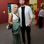 """18.05.2018.          <br /> More than 500 people attended the flagship event of the inaugural Unwrap LSAD Fashion Festival in Limerick.<br /> <br /> Pictured at the event were, Kristina Finlay and Jordan Finlay.<br /> <br /> The Limerick School of Art & Design, LIT, Fashion Design Graduate Exhibition and launch of the """"The Fashion Film"""" at Limerick City Gallery of Art, in partnership with EVA International, attracted hundreds of people from the world of fashion. <br /> <br /> A total of 27 fashion graduates presented their designs alongside the specially commissioned film by fashion stylist and creative director Kieran Kilgallon and videographer Albert Hooi. Picture: Alan Place"""