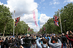 © Licensed to London News Pictures. 08/06/2019. London, UK. A flypast of RAF Red Arrows trailing red, white and blue smoke above The Mall and on the way over Buckingham Palace in a patriotic tribute to celebrate 93rd birthday of Queen Elizabeth II, Britain's longest reigning monarch. Photo credit: Dinendra Haria/LNP