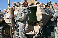 2228 MP Louisiana National Guard on base in Basra Iraq in lot where the MRAP's are ready to go.
