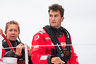 The Seven Star Triple Crown as part of Lendy Cowes week 2017. The Volvo Ocean Race VOR65 'Mapfre' shown here in action . Crewman Blair Tuke (NZL). The team raced around the island in 3 hours 13 minutes and 11 seconds setting a new world record, beating the previous record by almost seven minutes<br /> Credit Lloyd Images