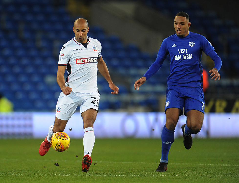 Bolton Wanderers' Karl Henry under pressure from Cardiff City's Kenneth Zohore<br /> <br /> Photographer Kevin Barnes/CameraSport<br /> <br /> The EFL Sky Bet Championship - Cardiff City v Bolton Wanderers - Tuesday 13th February 2018 - Cardiff City Stadium - Cardiff<br /> <br /> World Copyright © 2018 CameraSport. All rights reserved. 43 Linden Ave. Countesthorpe. Leicester. England. LE8 5PG - Tel: +44 (0) 116 277 4147 - admin@camerasport.com - www.camerasport.com