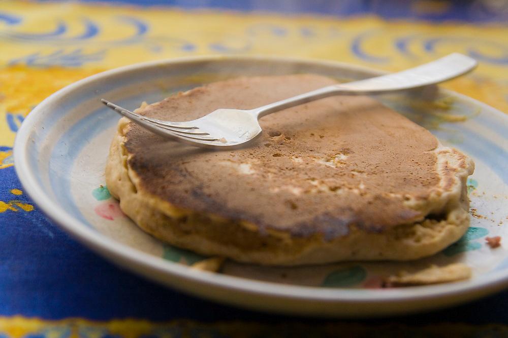 Steaming pancakes for breakfast in a winter cabin near Gold Bar, Washington.