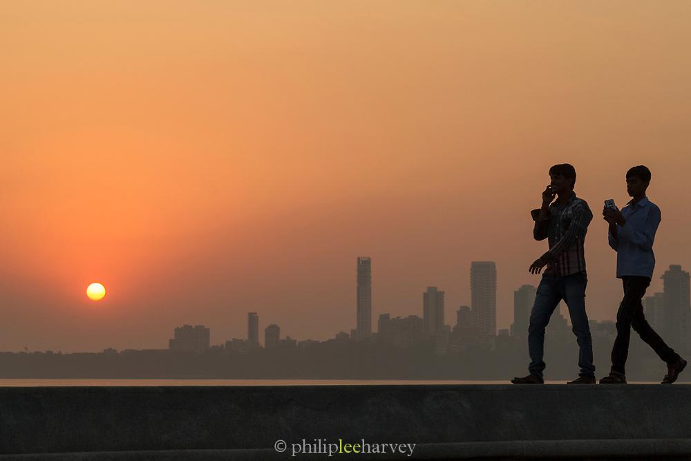 View of two guys walking on Marine Drive Promenade, Mumbai, India