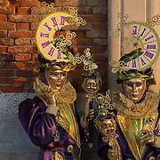 VENICE, ITALY - FEBRUARY 25:  A couple dressed in Carnival Costumes pose in Saint Mark's Square on February 25, 2014 in Venice, Italy. The 2014 Carnival of Venice will run from February 15 to March 4 and includes a program of gala dinners, parades, dances, masked balls and music events.  (Photo by Marco Secchi/Getty Images)
