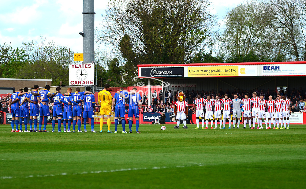 Minutes silence for the anniversary of the Bradford fire 30 years ago during the Sky Bet League 2 match between Cheltenham Town and Shrewsbury Town at Whaddon Road, Cheltenham, England on 25 April 2015. Photo by Alan Franklin.
