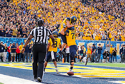 Sep 22, 2018; Morgantown, WV, USA; West Virginia Mountaineers wide receiver David Sills V (13) celebrates with teammates after catching a touchdown pass during the second quarter against the Kansas State Wildcats at Mountaineer Field at Milan Puskar Stadium. Mandatory Credit: Ben Queen-USA TODAY Sports