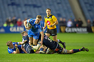 Jarryd Sage (#12) of Dragons Rugby is tackled by Ben Toolis (#5) of Edinburgh Rugby during the Guinness Pro 14 2018_19 match between Edinburgh Rugby and Dragons Rugby at BT Murrayfield Stadium, Edinburgh, Scotland on 15 February 2019.