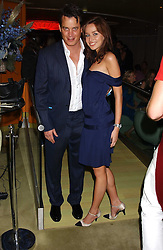 MATTHEW MELLON and NOELLE RENO at a fashion show by ISSA held at Cocoon, 65 Regent Street, London on 21st September 2005.<br /><br />NON EXCLUSIVE - WORLD RIGHTS