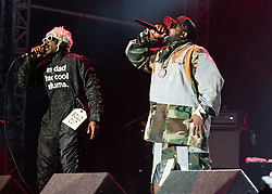 """© Licensed to London News Pictures. 05/09/2014. Isle of Wight, UK. Outkast performing live at Bestival 2014 Day 2 Friday.  In this picture - André """"André 3000"""" Benjamin (left), Antwan """"Big Boi"""" Patton (right).  Outkast are a hip hop duo consisting of rappers André """"André 3000"""" Benjamin and Antwan """"Big Boi"""" Patton.  This weekend's headliners include Chic featuring Nile Rodgers, Foals and Outcast.   Bestival is a four-day music festival held at the Robin Hill country park on the Isle of Wight, England. It has been held annually in late summer since 2004.    Photo credit : Richard Isaac/LNP"""