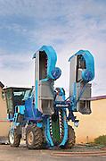 Mechanical harvesting tractor. Chateau de Haux, Bordeaux, France
