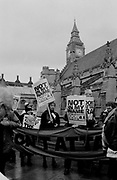 Crowds gathering outside the English Parliament in protest to the invasion of Iraq.