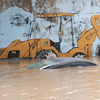 The top of a submerged car is visible in a flooded area after hurricanes Eta and Iota, near La Lima, Cortés, Honduras.