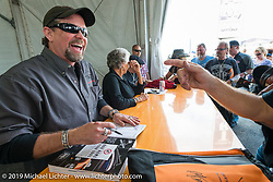 The Davidson Family (Bill, Nancy and Willie G) sign autographs on Wednesday during the Ride-In Show at the Harley-Davidson display during Daytona Bike Week. FL, USA. March 12, 2014.  Photography ©2014 Michael Lichter.