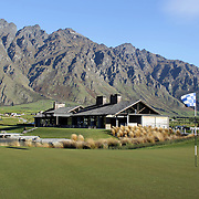 The 18th hole and Club House at Jack's Point Golf Course. Jack's Point Golf Course, Queenstown New Zealand is considered one of the top 100 golf courses in the world. Set within a 3,000 acre nature preserve on the shores of Lake Wakatipu, Jacks Point has sweeping lake and alpine vistas with a 360-degree mountain scape. The course is bounded by the Remarkables mountain range and Lake Wakatipu. Queenstown, Otago, New Zealand. 26th November 2011. Photo Tim Clayton
