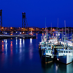 The commercial fishing pier with the Memorial Bridge in the background, Portsmouth, New Hampshire.