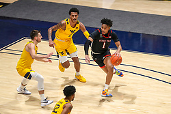 Jan 25, 2021; Morgantown, West Virginia, USA; Texas Tech Red Raiders guard Terrence Shannon Jr. (1) drives against West Virginia Mountaineers forward Jalen Bridges (2) and guard Jordan McCabe (5) during the second half at WVU Coliseum. Mandatory Credit: Ben Queen-USA TODAY Sports