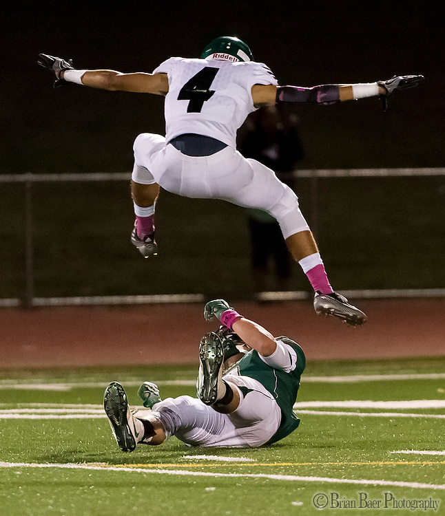El Camino Eagles Zach Buick (4), jumps over Rio Americano Raiders Ryan Porter (8), after his missed pass during the first quarter as the El Camino Eagles host the Rio Americano Raiders at Del Campo High School, Friday Oct 7, 2016. <br /> photo by Brian Baer