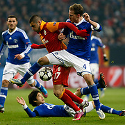 FC Schalke 04's Howedes and Galatasaray's Burak Yilmaz during their UEFA Champions League Round of 16 Second Leg match FC Schalke 04 between Galatasaray at the Gelsenkirchen stadium, Germany, on March 12, 2013. Galatasaray won 3-2. Photo by TURKPIX