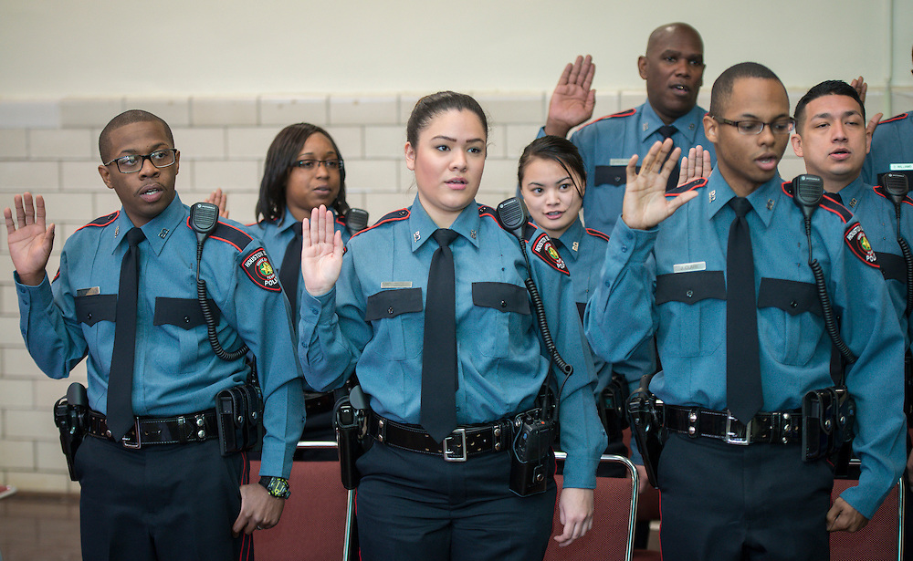 New officers take the Oath of Office during a swearing-in ceremony for new officers at the Houston ISD Police Department, March 3, 2014.
