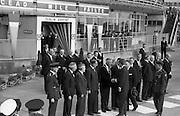 President John F. Kennedy arrives at Dublin Airport.  Kennedy replies to President de Valera's speech of welcome.  Onlookers include President Kennedy's sisters, Mrs. Eunice Shriver and Mrs. Jean Smith; An Taoiseach Seán Lemass; An Tanaiste Mr. McAntee; Dr. Ryan, Minister for Finance, and Mr. Frank Aiken, Minister for External Affairs..26.06.1963