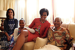 June 21, 2011 - Johannesburg, South Africa - U.S. First Lady MICHELLE OBAMA (2-R), her daughters, MALIA (L) and SASHA (2-L)  with former President NELSON MANDELA (R) at his home in Houghton. Michelle Obama is on her first solo trip to Africa. (Credit Image: © Nelson Mandela Foundation/ZUMAPRESS.com)