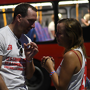 A couple comfort each other after England loss to Croatia the 2018 FIFA World Cup semi-finals in Moscow at the Hype park underground on 11 July 2018.