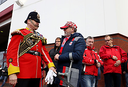 Fans and members of the military outside the ground before the match