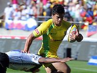 Australia's Alan Fa'alava'au fends off a Fijian tackler at the IRB International Rugby Sevens, Westpac, Wellington, New Zealand, Friday, February 01, 2013. Credit:SNPA / Ross Setford