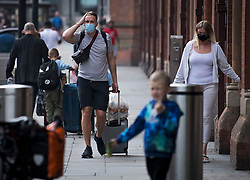 © Licensed to London News Pictures. 16/08/2020. London, UK. Passengers travelling on the Eurostar arrive at St Pancras International after France was removed from the list of safe countries people can travel to without going into quarantine. From 4am yesterday morning (Sat) anybody returning to the UK from France will be required to self isolate for two weeks, following an increase in Covid-19 cases in France. Photo credit: Ben Cawthra/LNP