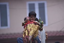 July 6, 2018 - Kathmandu, NP, Nepal - A little girl reacts as balanced on top of a chariot during the Trishul Jatra festival celebrated in Jayabageshwari, Kathmandu, Nepal on Friday, June 06, 2018. On this day a chariot is pulled around the streets and Festival is celebrated by Hindus who believe that their children will be blessed by good health after participation in the ritual. (Credit Image: © Narayan Maharjan/NurPhoto via ZUMA Press)