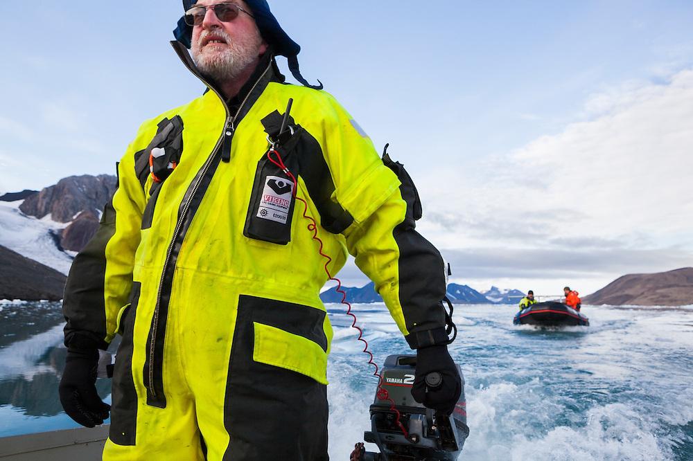 Glaciologist Jacek Jania leads boats up fjord on a field expedition to Samarinbreen glacier, Hornsund, Svalbard.