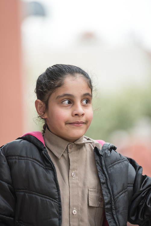 19 February 2020, Amman, Jordan: 10-year-old Bayan, a girl born with Cerebral Palsy, attends the Al Yarmouk Primary Mixed School, in the Lewa'a Al Jama'a district. Following three years in a school exclusively for children with disabilities, today she attends 4th grade at Al Yarmouk, which has recently opened up to receive her. The school teaches some 750 students from 1st - 6th grade, most of them Jordanian, but some also from Syria and other countries. The school has received support from the Lutheran World Federation in refurbishing their buildings and classrooms, as well as training on protection and social cohesion, including how to become more inclusive of children with disabilities.