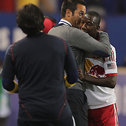Bradley Wright-Phillips, New York Red Bulls, is congratulated by Coach Mike Petke while subbing him after he had completed his hat trick of goals during the New York Red Bulls Vs Seattle Sounders, Major League Soccer regular season match at Red Bull Arena, Harrison, New Jersey. USA. 20th September 2014. Photo Tim Clayton