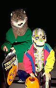 Halloween trick or treaters age 7 and 9 in costume.  St Paul  Minnesota USA