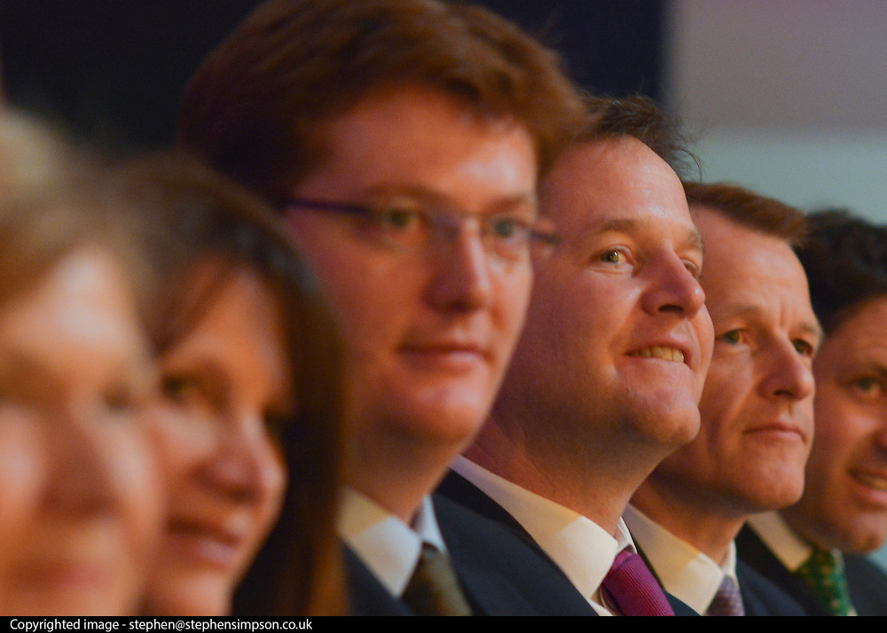 © Licensed to London News Pictures. 09/03/2013. Brighton, UK. (L-R) Danny Alexander, Liberal Democrat MP, Chief Secretary to the Treasury, Leader of the Liberal democrats and Deputy Prime Minister Nick Clegg and David Laws, Liberal Democrat MP, Minister of State at the Cabinet Office and Department for Education vote for a motion at the Liberal Democrat Spring Conference in Brighton today 9th March 2013. Photo credit : Stephen Simpson/LNP