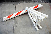 fallen over sawhorse on the sidewalk