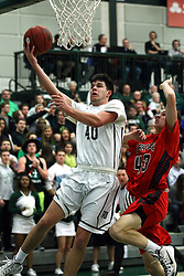 10 January 2015:  Alec Bausch gets past Mike Leazer for a lay up during an NCAA mens division 3 CCIW basketball game between the Carthage Reds and the Illinois Wesleyan Titans in Shirk Center, Bloomington IL