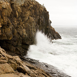 Surf crashes on the cliffs at Great Head in Maine's Acadia National Park.
