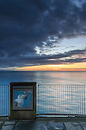 A view on the open sea at sunset from the footpath known as Love Trail (Via dell'Amore), linking Riomaggiore to Manarola, two of the five villages alltogether known as Cinque Terre in Italy.