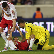 Tim Cahill, New York Red Bulls, goes head over heals as he misses a chance saved by Toronto goalkeeper Freddy Hall during the New York Red Bulls V Toronto FC  Major League Soccer regular season match at Red Bull Arena, Harrison. New Jersey. USA. 29th September 2012. Photo Tim Clayton