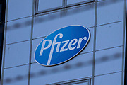 A Pfizer sign is pictured through barbed wire outside the Pfizer plant in Discovery Park on 4th October 2021 in Sandwich, United Kingdom. Pfizer functions located at Discovery Park include Pharmaceutical Sciences, Safety & Regulatory, Medical, QA and Business Support.