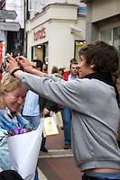 Man demonstrating head messager on Grafton Street in Dublin Ireland