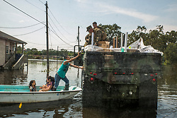 U.S. Marines assigned to the 14th Marine Regiment, 4th Marine Division, Marine Forces Reserve, and Marine Wing Support Squadron 473, 4th Marine Aircraft Wing, MARFORRES, hands supplies to a family in Orange, Texas, Sept. 3, 2017. Hurricane Harvey landed in eastern Texas on Aug. 25, 2017, flooding thousands of homes and displaced over 30,000 people. (U.S. Marine Corps photo by Lance Cpl. Niles Lee)  Please note: Fees charged by the agency are for the agency's services only, and do not, nor are they intended to, convey to the user any ownership of Copyright or License in the material. The agency does not claim any ownership including but not limited to Copyright or License in the attached material. By publishing this material you expressly agree to indemnify and to hold the agency and its directors, shareholders and employees harmless from any loss, claims, damages, demands, expenses (including legal fees), or any causes of action or allegation against the agency arising out of or connected in any way with publication of the material.