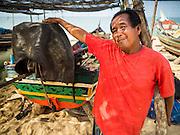 15 JUNE 2105 - BAN THONG, NARATHIWAT, THAILAND:  A fisherman in Ban Thong talks about his life and subsistence fishing.      PHOTO BY JACK KURTZ