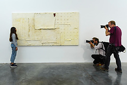 "© Licensed to London News Pictures. 11/09/2019. LONDON, UK. Press photographers next to ""Chenille #7"", 2018, by Harmony Hammond.   Preview of a new exhibition by Harmony Hammond whose works are on show alongside those of Mona Hatoum at White Cube gallery in Bermondsey.    The show runs 12 September to 3 November 2019.  Photo credit: Stephen Chung/LNP"