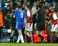 Photo: Scott Heavey.<br />Chelsea v Arsenal. Champions League Quarter Final, First Leg. 24/03/2004.<br />Frank Lampard and Robert Pires have words before walking down the tunnel at half time