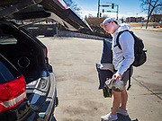 "13 MARCH 2020 - DES MOINES, IOWA: GAGE VANDERLEER, a first year student at Drake University, packs his car before going home for spring break. The Governor of Iowa announced Friday that 17 people in Iowa have tested positive for the Novel Coronavirus. Of those, 15 people were exposed on the same cruise in Egypt, the others were exposed through travel but were not on the same cruise. The Governor said there has not yet been any ""community spread"" in Iowa. All of the Iowans who have tested positive are in self quarantine. Across Iowa, municipalities and businesses are taking steps to implement ""social distancing."" Most of the colleges in Iowa, including Drake University, have announced that they will remain closed after their spring breaks and that classes will move to online only, after spring break. Many businesses in Des Moines, including Nationwide Insurance and EMC Insurance, have announced plans to have their employees to telecommute. The mayor of Des Moines has urged event planners to consider canceling large events.     PHOTO BY JACK KURTZ"