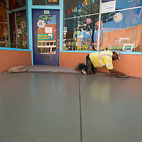 073013       Brian Leddy<br /> Ronald Perry of Joe Wauford Construction puts the finishing touches on the sidewalk in front of the Makeshift Gallery Tuesday morning. The new sidewalk and curb was replaced to stop water and ice buildup that occurs in the winter.