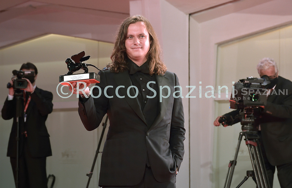 """VENICE, ITALY - SEPTEMBER 12: Michal Sobocinski poses with the Award for Best Screenplay on behalf of Indian director Chaitanya Tamhane for """"The Disciple"""" during the winners photocall at the 77th Venice Film Festival on September 12, 2020 in Venice, Italy.<br /> (Photo by Rocco Spaziani)"""